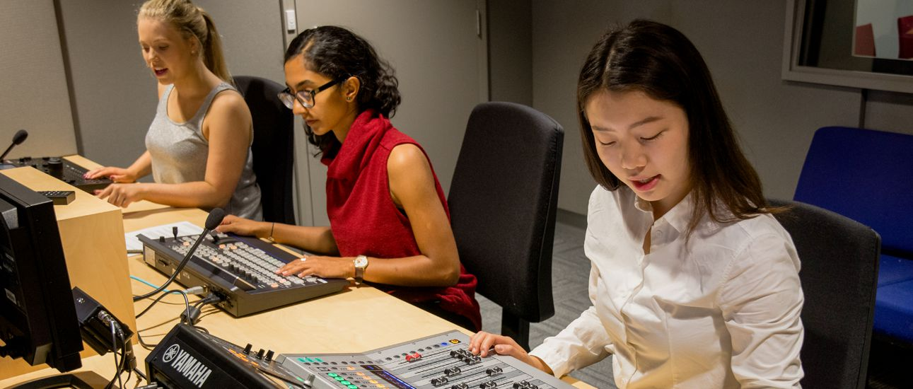 three-female-students-sitting-in-recording-studio
