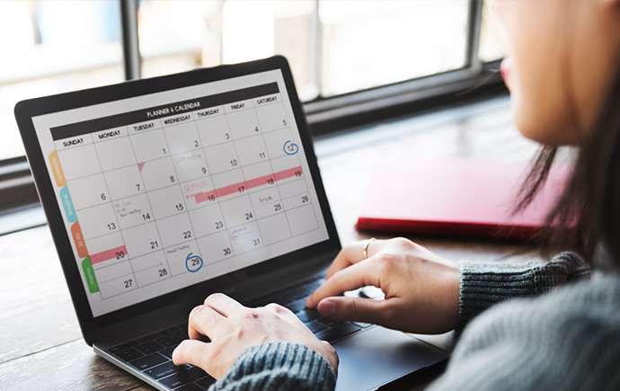 Student checking calendar on laptop