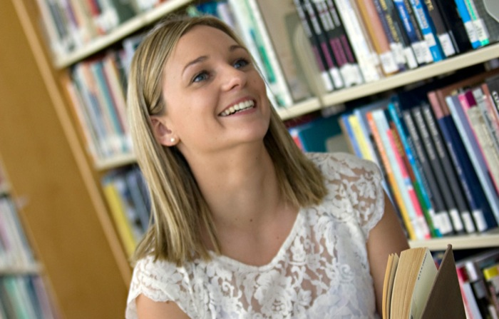 blond female student looking happy