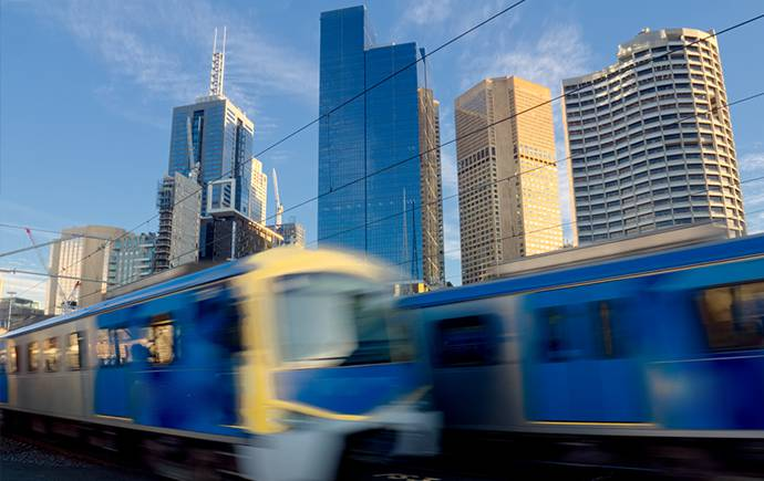 Trains with Melbourne skyline