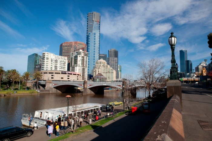 the Yarra River with Melbourne cityscape in the background, including the famous Eureka tower.