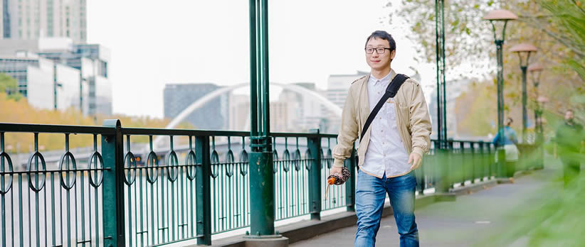 Monash College student walking along the Yarra River in Melbourne