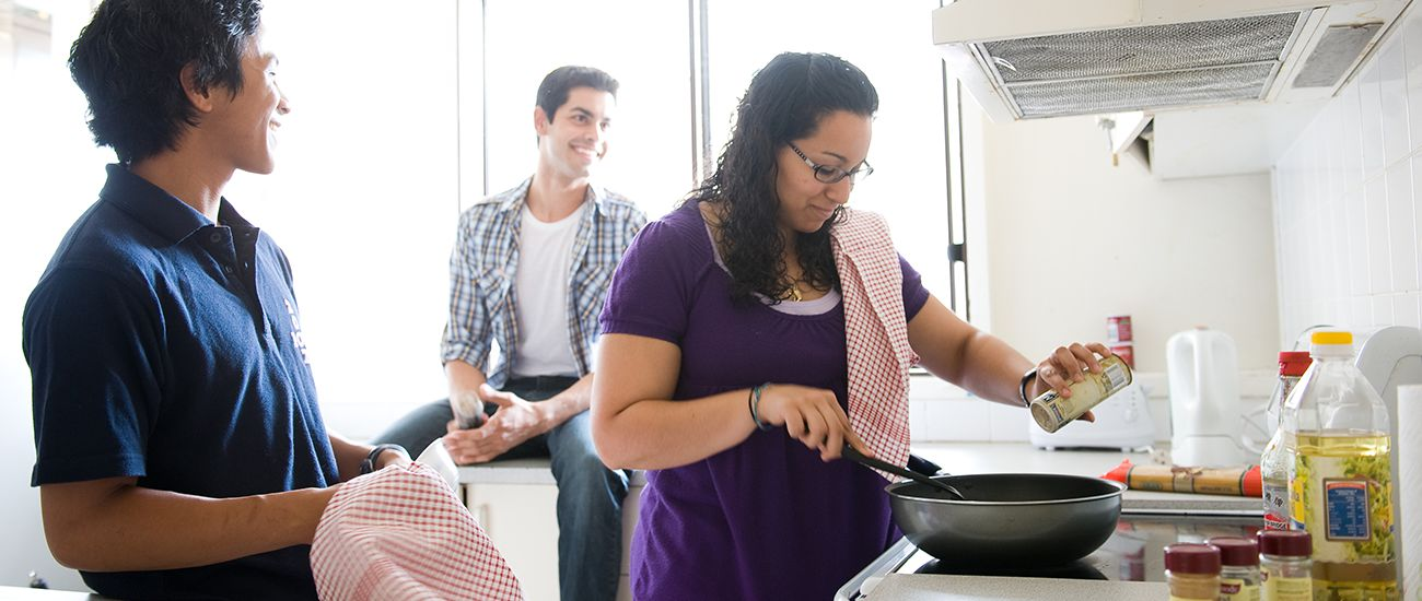Students cooking at their Monash on-campus accommodation