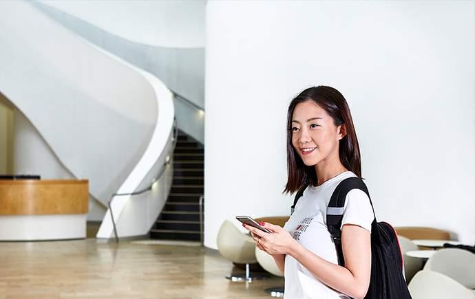 Student in atrium