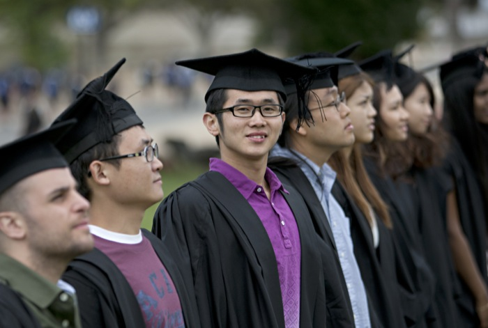 line of graduating students wearing mortarboards