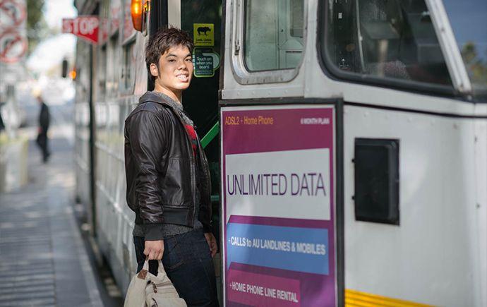 Monash College student boarding a Melbourne tram